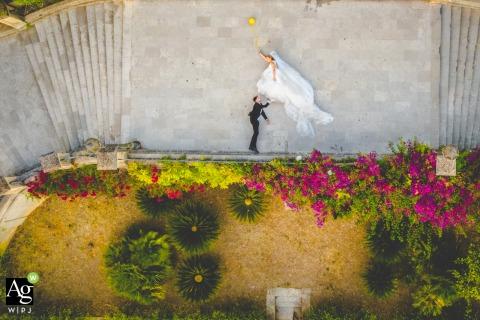 Duomo San Giorgio, Modica bride and groom posing during a drone camera portrait session