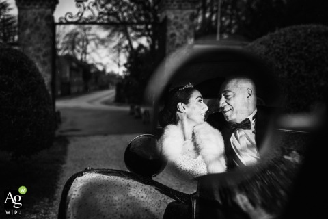 Paris couple posing for a wedding picture with a bw reflection on a vintage auto side mirror