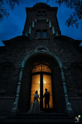 St. Nedelya Church, Sofia wedding couple posing for a portrait showing their Silhouettes and the church