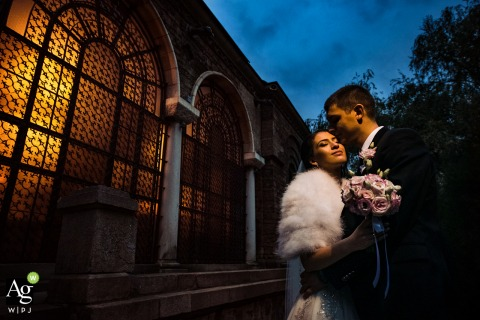 St. Nedelya Church, Sofia bride and groom posing during a portrait session next to the church during the blue hour