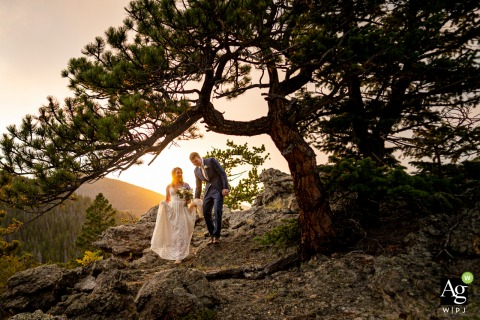 Rocky Mountain National Park wedding couple during an elopement, with four people present	and evening vows