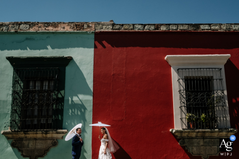 Oaxaca City artistic wedding photography of bride and groom on their wedding day on an classic colorful Oaxacan street