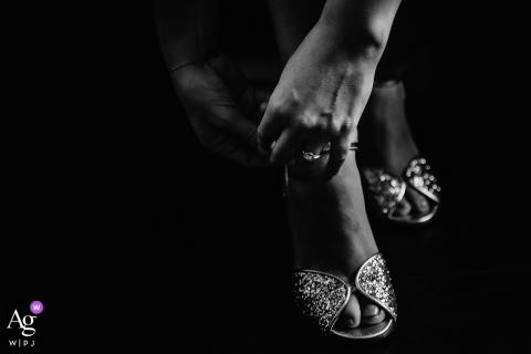 Lyon wedding photographer created this artistic image of the bride putting on her shoes