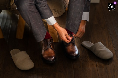 Zhejiang China detail image of the groom's wedding shoes being tied