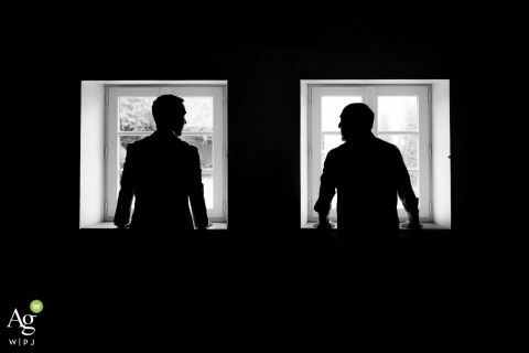 Gite de Fonteneilles wedding picture with two silhouettes framed in the bright windows