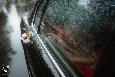 China wedding detail photography with the raindrops covering the outside of the car