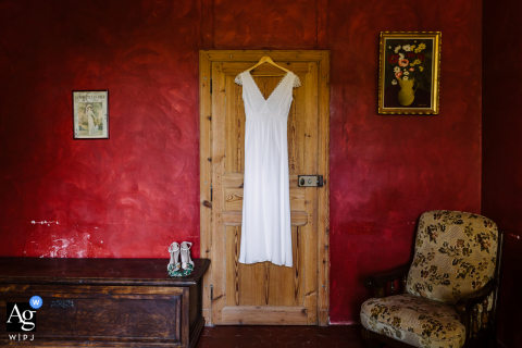 Domaine du Petit Mylord bridal gown image hanging on a door