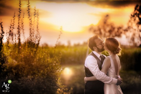 Sovizzo, Veneto, Villa Curti couple posing for a wedding picture at sunset under the warm colors in the sky