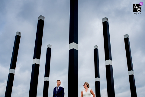 Fotoshoot, Gorinchem artistic wedding photo with pillars of love against a cloudy sky