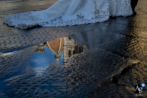 Florence, Tuscany artistic wedding photo of the couple Walking in town with a puddle Reflection