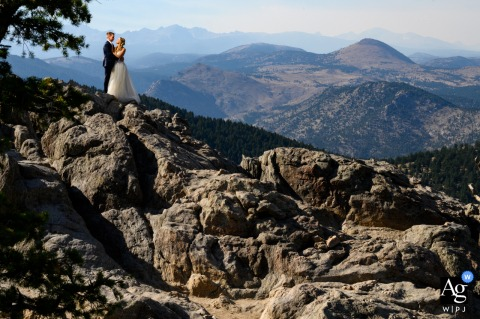 Boulder, CO artistic wedding photo of the couple from A scenic viewpoint overlooking the mountains west of Boulder