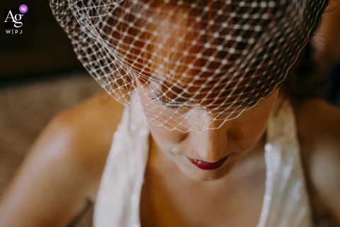 Siena, Tuscany artistic wedding photo at Home with the veil and the bride