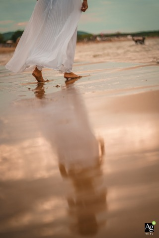 Bulgaria, Black Sea wedding bride posing for a portrait as she walks before the ceremony on the Beach at Papur Beach & Bar