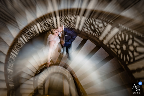 Chicago wedding photographer captured this artistic portrait of a couple of stairs at the Rookery Building