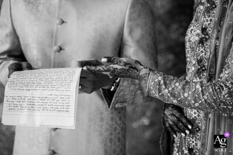 Dubai wedding detail pic in black and white of the groom receiving a letter at The Four Seasons
