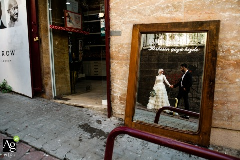 Istanbul wedding bride and groom portrait reflection from a mirror. Mirror says, All eyes on us'