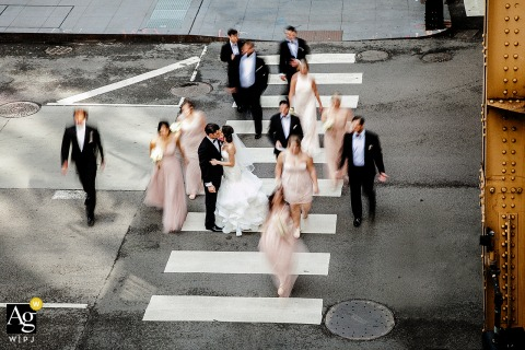 Downtown Chicago Bridal Party Portrait of the wedding group being captured from above as they cross a city street crosswalk