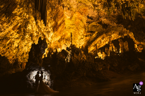 Slovenia wedding photographer captured this newywed portrait of the coupe's silhouette on the walls of Postojna Cave