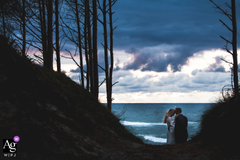 Artistic Baltic Coast wedding portrait of the bride and groom in Leba, Poland