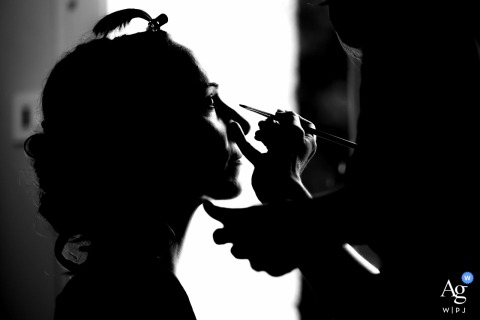 Vendée, France silhouette detail shot of the Bride having her makeup done at Domaine de la Gerberie