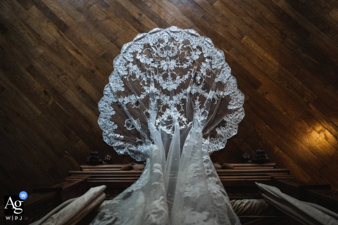 Brissac-Quincé, France artistic wedding detail image showing The veil looking like a tree on the wood floors
