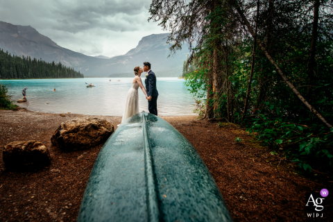 Yoho National Park wedding portrait of couple kissing and holding hand at Emerald Lake