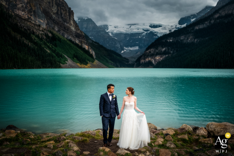 Canada artistic wedding portrait from Lake Louise, Banff National Park, AB on a Raining day