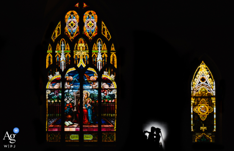 VA artistic wedding portrait from Arlington of the posed couple at the church