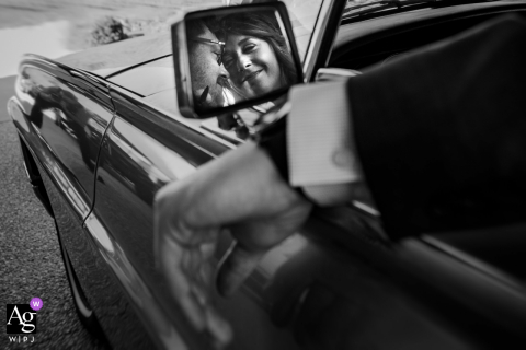 Side view mirror b&w wedding portrait of the couple leaving in their classic car at Yonah Mountain Vineyards, Cleveland, Georgia
