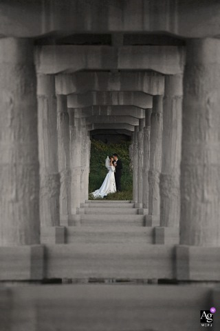 Hotel outdoor Portrait of the bride and groom in an artistic wedding photo