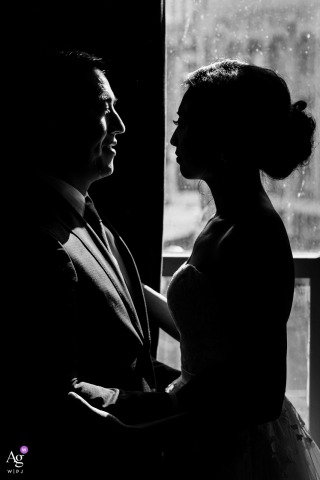 B&W downtown Seattle Studio artistic wedding pic against window lighting