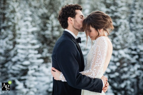 Big Sky, MT wedding couple posed portrait session with snowy trees as their backdrop