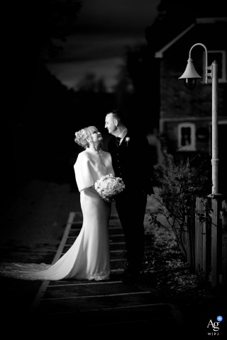 Hampshire, England creative wedding couple portrait session at night in black and white by a lamp post