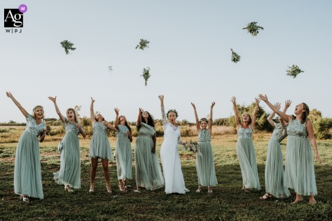 Les serres de l'île de Ré, France creative bridal party portrait with a Group of girl throwing their bouquets