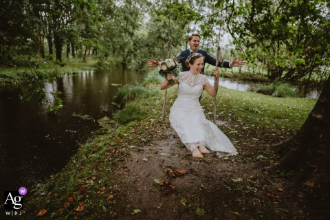Moulin du champs, France creative couple wedding portrait outdoors by the water with The bride on a swing