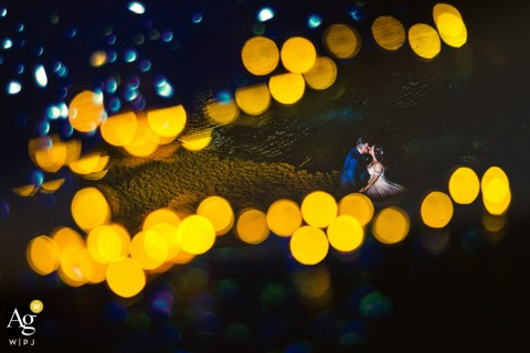 Syracuse, Sicily fine art wedding portrait with yellow bokeh lights and sea