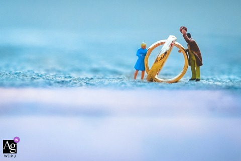 Syracuse, Sicily creative wedding detail image of the rings with small figurine people