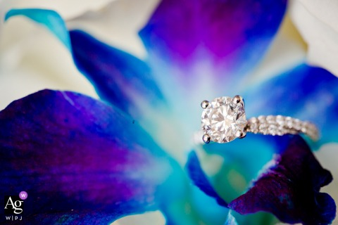 Houston, Texas creative wedding detail image of Her ring on blue orchid, the bride's favorite flower