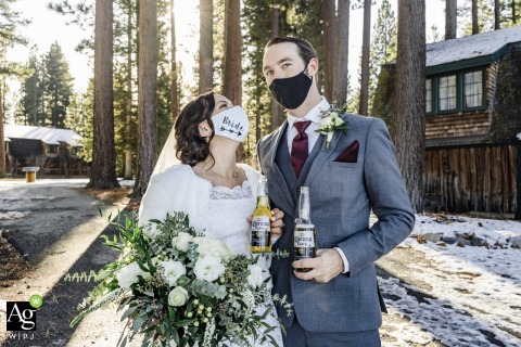 Valhalla Pier, South Lake Tahoe, CA bride and groom wedding portrait session of newlyweds wearing their masks and holding Corona beers to celebrate their wedding in 2020