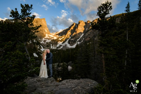Rocky Mountain National Park couple posing for wedding images at sunrise after their vow exchange in private