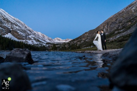 Colorado bride and groom wedding portrait session at sunrise by the lake
