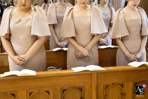 Holy Rosary Church, Bangkok creative wedding picture of bridesmaids dresses while standing in the pews
