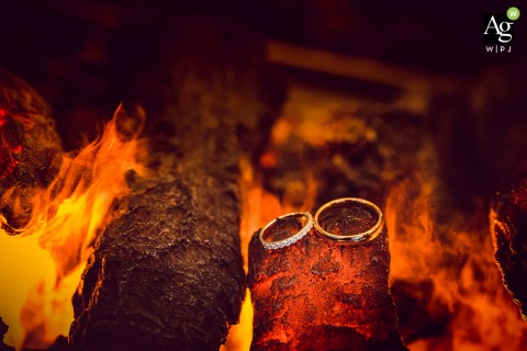Creative wedding detail image from Bulgaria of the rings in the hotel fireplace