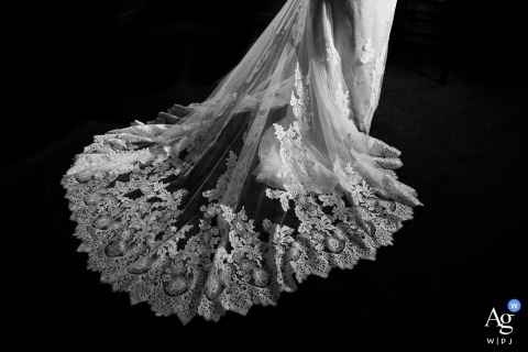 Estes Park, Colorado creative wedding detail image with a dramatic train standing out against the dark carpet