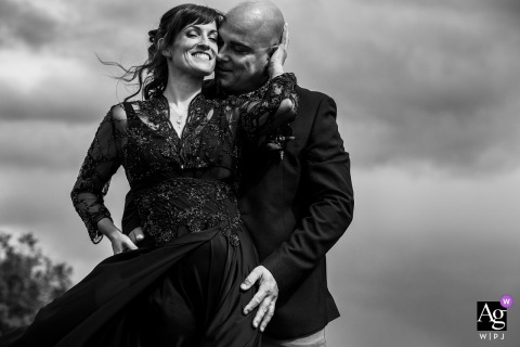 Vittel creative couple wedding portrait in black and white against the clouds in the sky
