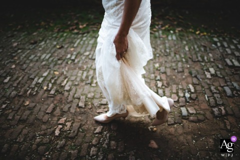 San Galgano Abbey, Tuscany fine art wedding detail pic of the bride's dress and shoes walking on stones