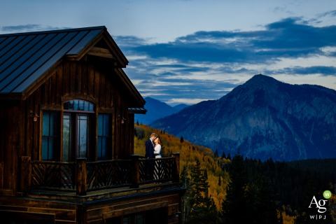 Crested Butte, CO couple standing just outside their reception space for their Crested Butte Wedding