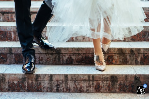 Sofia, Bulgaria creative, fine art wedding photo showing the shoes of the bride and groom coming down the stairs