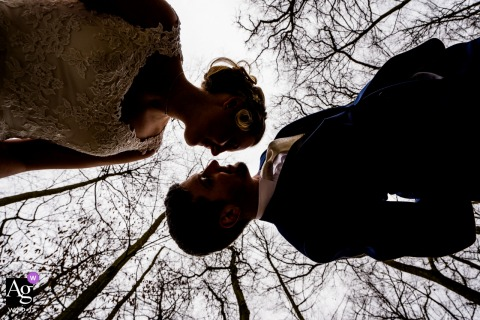 Frankfurt creative wedding Couple portrait in the woods, as seen from below them and the forest trees