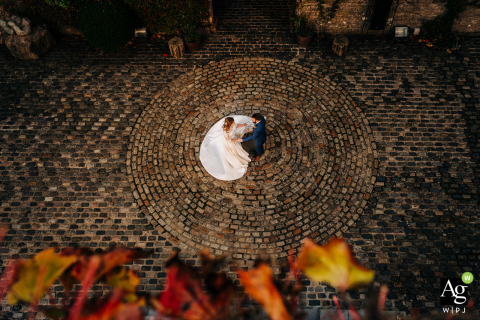 Walton Castle, Somerset, England wedding couple posed portrait session of the bride and groom dancing in castle courtyard, captured from above